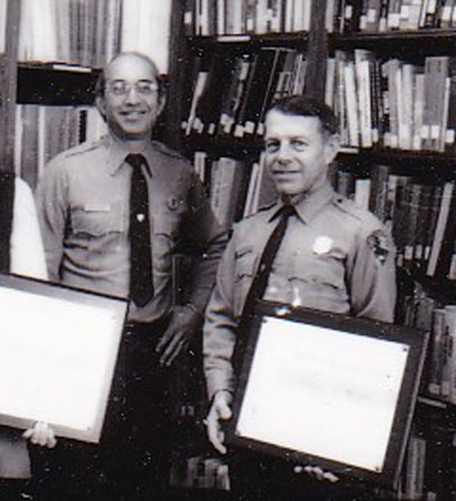 Tom Bredow receives Special Achievement award from Chief Ranger Bill Ferraro