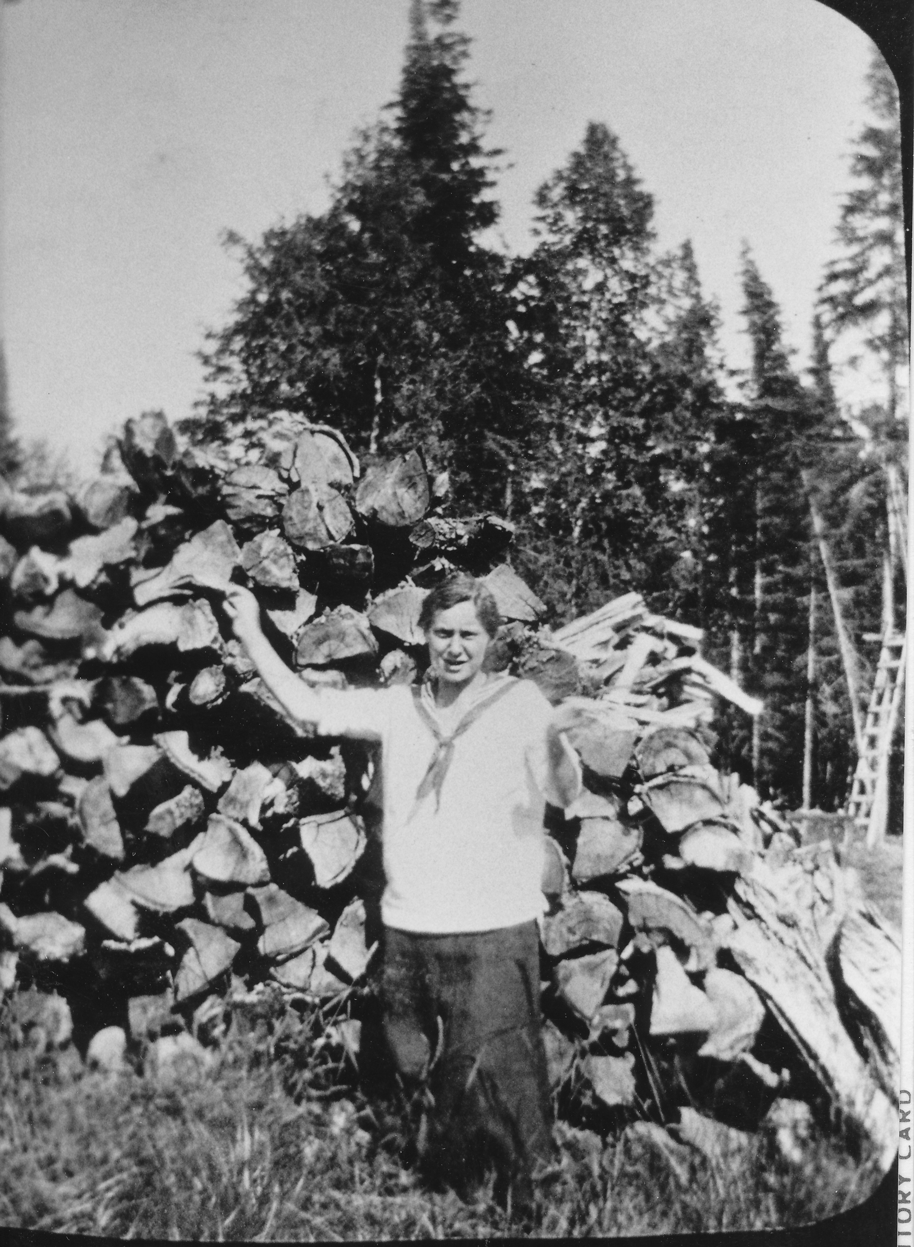 Gert by the wood pile at the West Bay Club in 1916