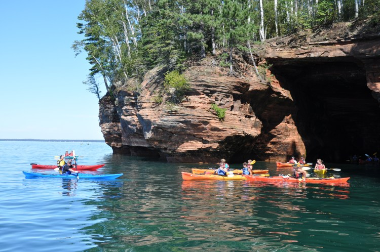 Dan (in the blue kayak) with a group of paddlers at the mainland sea caves