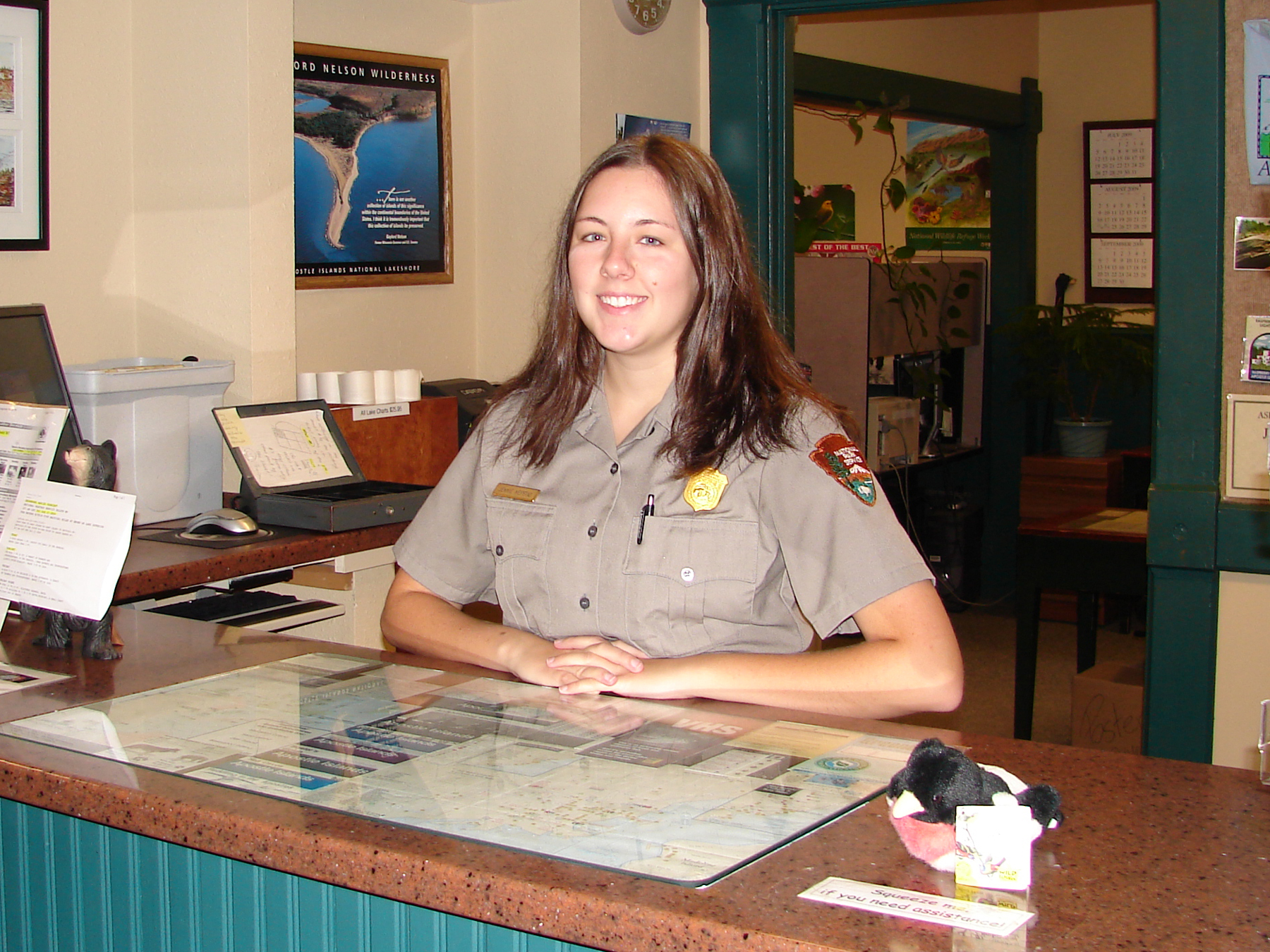 Jennie staffing the information desk at the park's Bayfield headquarters