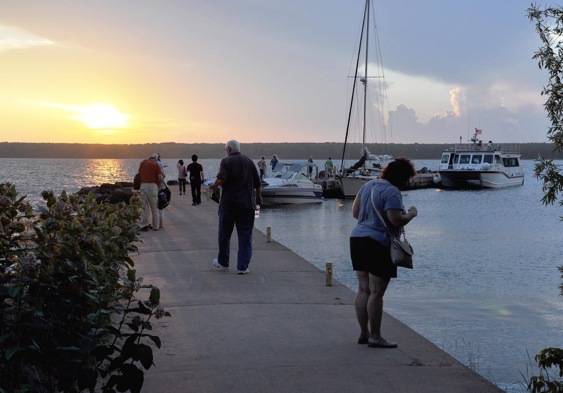 Visitors enjoy the sunset at Presque Isle