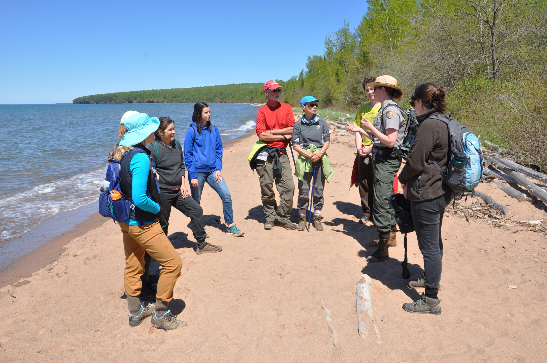Sophie (far right) with ranger Caroline Twombly and park staff at Meyers Beach during seasonal training