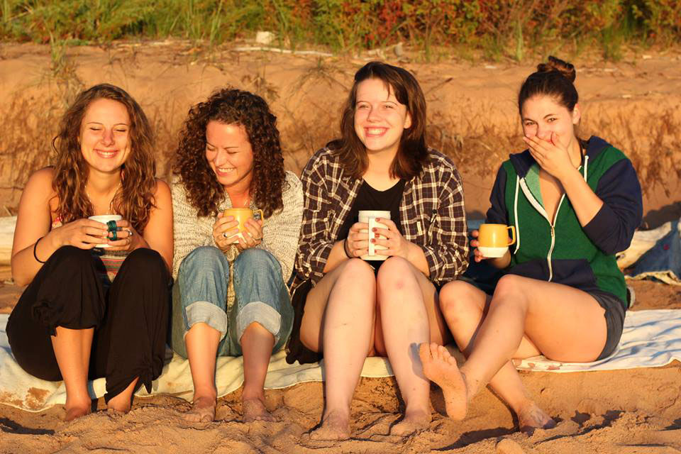 Sophie (second from right) enjoying coffee with friends at sunrise on Julian Bay beach