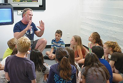 Summer Campers learning about drawing and animation from Dan Dudley.