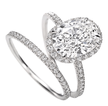 Show-stopper - We're now into big boy territory. This stonking great Harry Winston duo are certainly eye catching but through incredible craftsmanship, manage to retain delicate proportions. This Oval micropave diamond engagement ring boasts a 2.25ct central diamond in micropave platinum setting.
