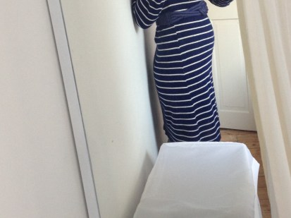 Excited to show off my tiny bump in my first maternity dress