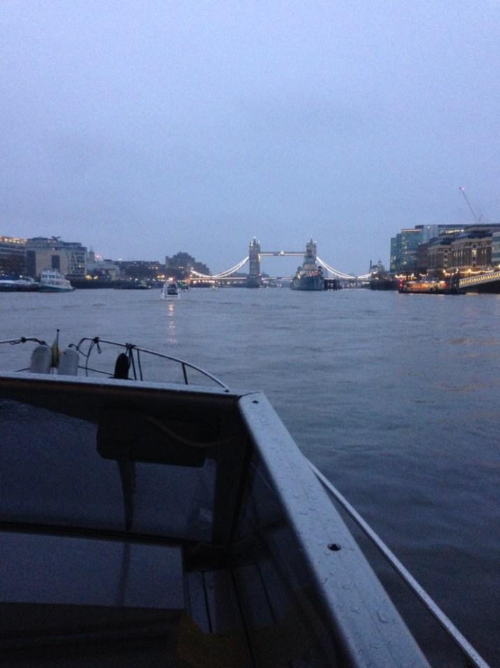 Passing under London Bridge and catching sight of the amazingly illuminated Tower Bridge
