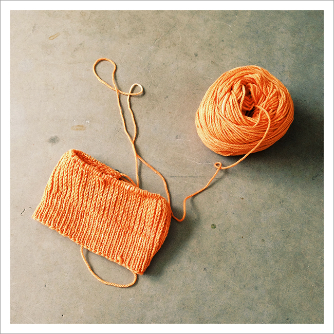 orange Heel Stitch Hat knitting in progress
