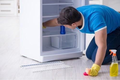 man-cleaning-fridge
