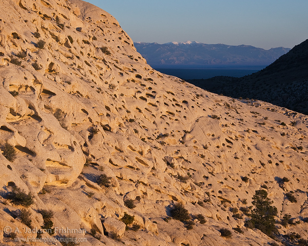 Dawn illuminates the eroded face of Crystal Peak in Western Utah