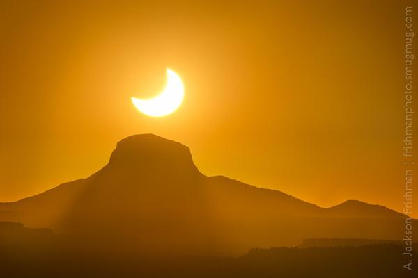 Solar eclipse over Cabezon Peak, New Mexico