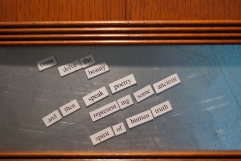 magnetic poetry on the hymn board