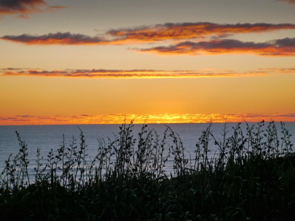 sunset at karioitahi beach