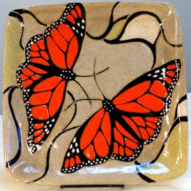 Stoneware plate, sgraffito carved monarch butterfly design