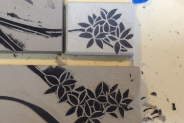 Stoneware tiles, sgraffito carving in progress