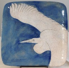 Square stoneware plate with sgraffito carved egret design