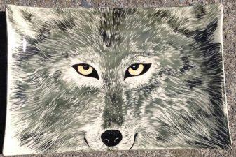 Ceramic platter, sgraffito wolf design
