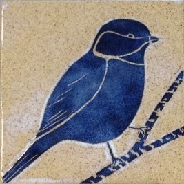 Stoneware tile, sgraffito carved chickadee design