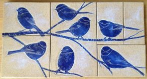 Mosaic wall tiles, sgraffito chickadee design