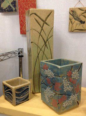 Square stoneware vases, sgraffito blossoms and grasses