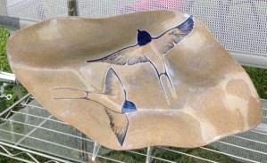 Stoneware bowl, sgraffito carved swallows design