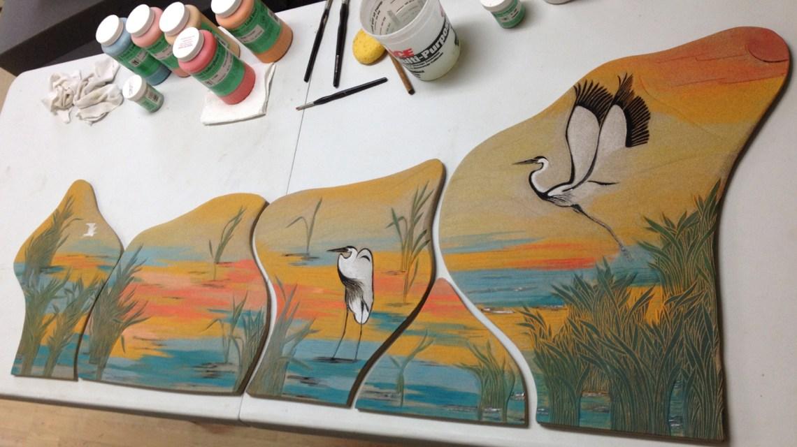 Studio photo; wall tiles work in progress; wetlands motif, herons, grasses