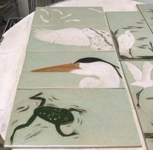 Ceramic tiles, sgraffito carved frog & heron