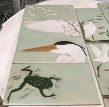 Ceramic tiles, sgraffito carved frog & heron
