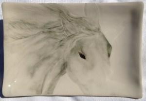 Stoneware platter, sgraffito carved horse design