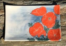 Stoneware platter, sgraffito carved poppies design