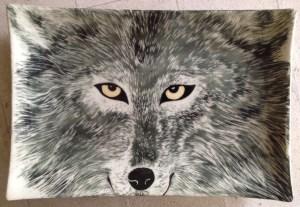 Stoneware platter, sgraffito carved wolf design