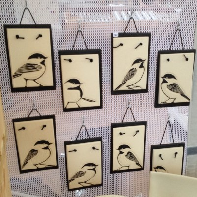 Collection of hanging tiles, sgraffito carved chickadee designs