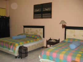 This is the first time I stayed alone in a hotel room, but having 2 beds. Kupang story.