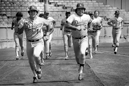 Dodger pitcher Fernando Valenzuela races with Mike Scioscia in their first full workout since the strike on Aug. 1, 1981.