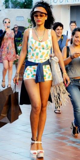 http://styledarlingonline.files.wordpress.com/2012/07/rihanna-in-a-pineapple-printed-topshop-romper-with-a-gold-statement-necklace-leather-bag-platform-heels.jpg