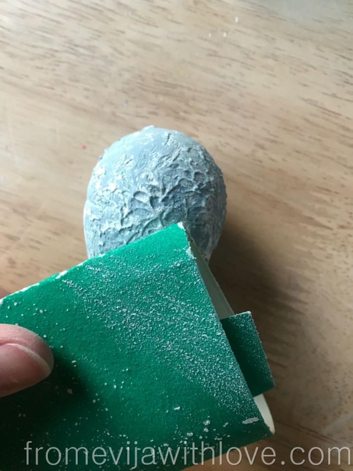 sanding the easter egg creating the textured egg for easter wreath