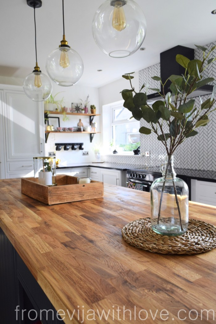 wooden worktops and vase with greenery