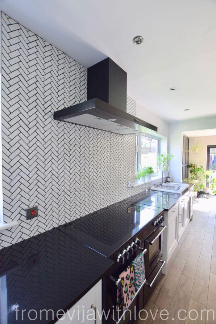 herringbone tile backsplash black granite worktops
