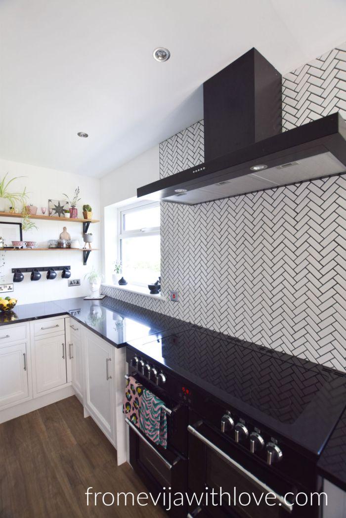 black granite and black appliances