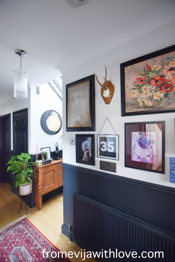 Hallway with eclectic artwork and gallery wall