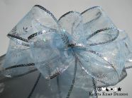 Sheer Blue and Silver Snowflake Bow for wreaths, trees, home décor, or your packages.