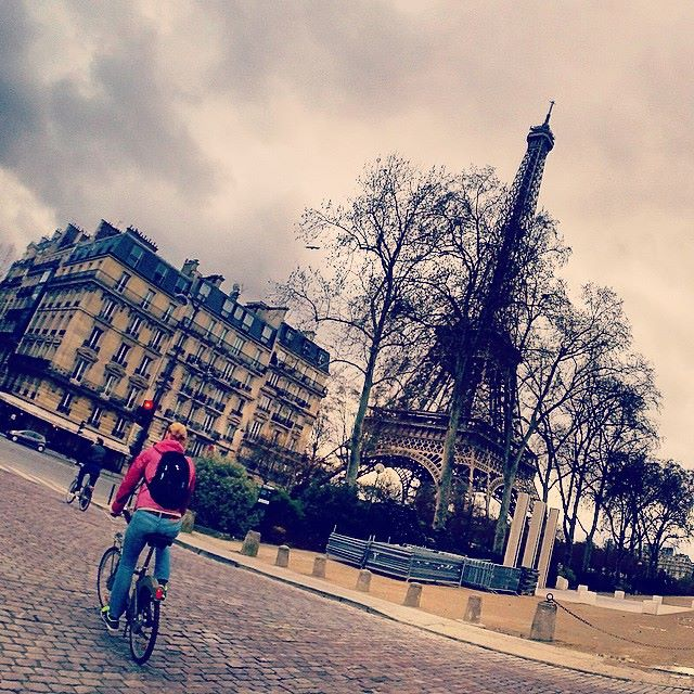 Cycling by the Eiffel tower in Paris
