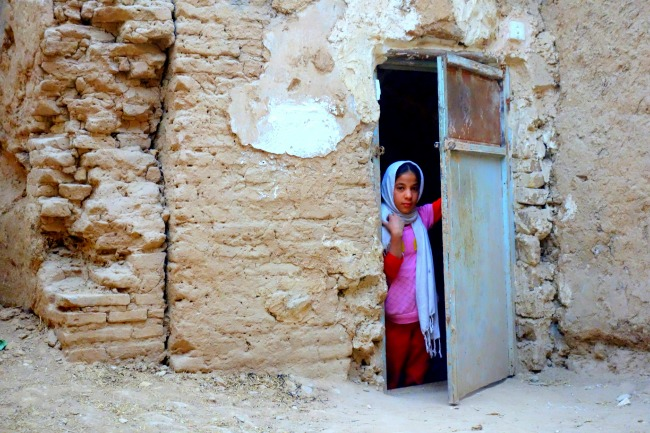 Young girl living in a mud house in Yazd