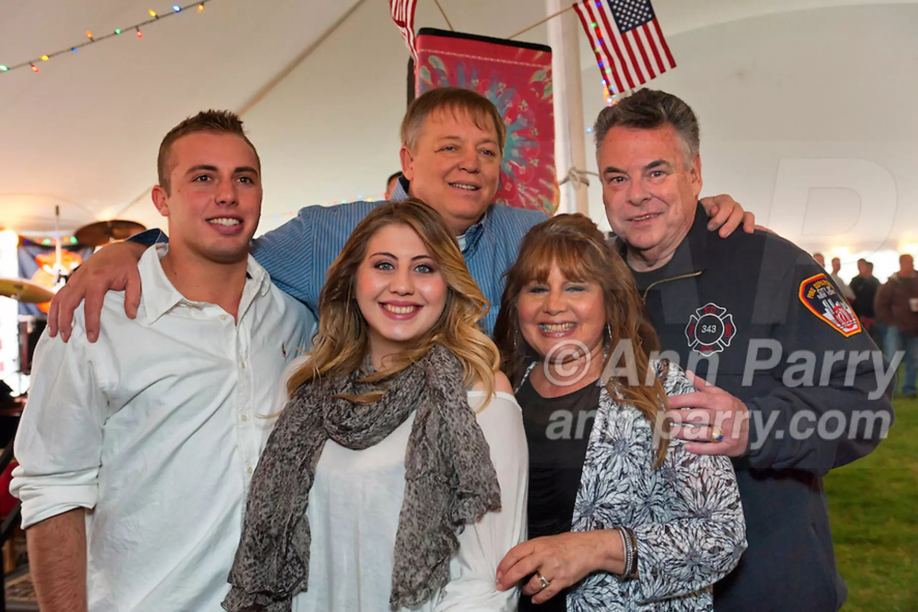 East Meadow, New York, USA. March 31, 2012. Firefighter Ray Pfeifer, his wife Caryn Pfeifer, their son Terrence Pfeifer and daughter Taylor Pfeifer, and New York Congressman Pete King pose for picture at Fundraiser for Ray Pfeifer - battling cancer after months of recovery efforts at Ground Zero following 9/11 2001 Twin Towers attack = at East Meadow Firefighters Benevolent Hall.