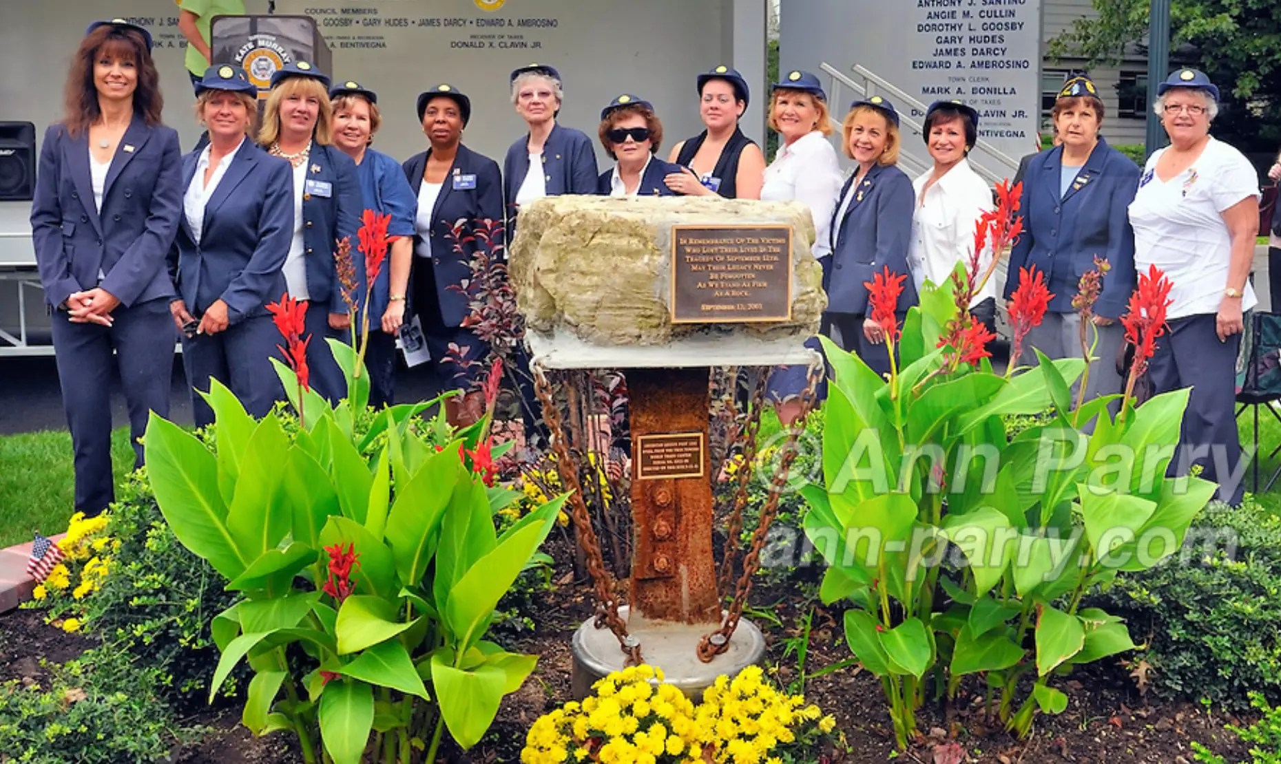 Merrick, NY, USA. Sept. 11, 2011. Merrick Auxiliary Unit of Merrick Post 1282 of American Legion, (L-R) MARGARET BEIGELMAN, DEBRA BERNHARD, CLAUDIA BORECKY, FLORENCE HOFFMAN, DELORES PARSONS, BRIDEE TONN, LUCY MURPHY, DIANNE CANCRO, PAT TROPEA, SHARON WILLIAMS, BETTY TUCKER, BARBARA BYRNE, and FAY AMBROSINO, at 9/11 event dedicating monument with steel from site of World Trade Center, at Merrick Veterans Memorial Park.