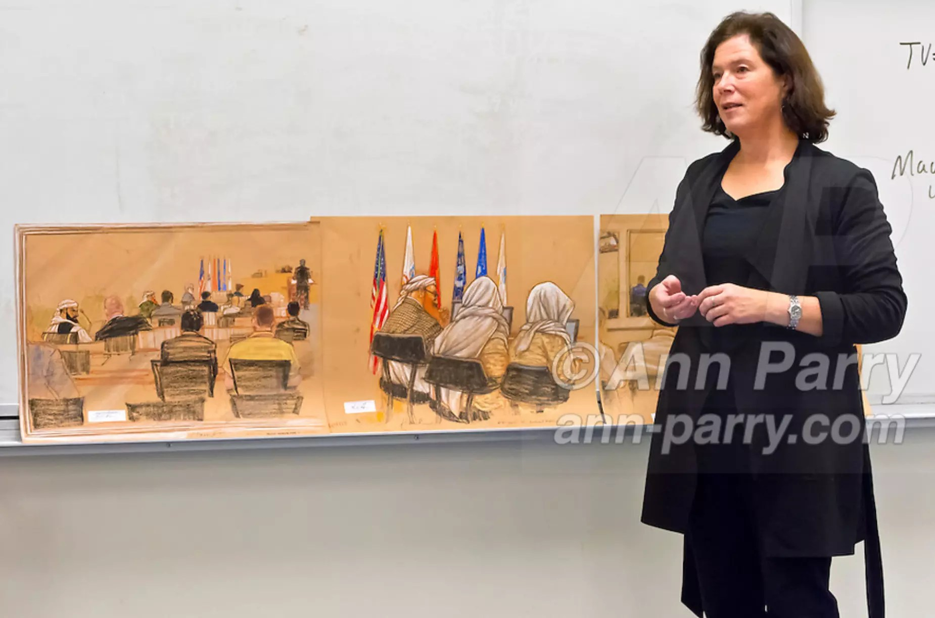 "Hempstead, NY, U.S. 12th Nov., 2013. Janet Hamlin, a courtroom artist covering the military tribunals at Guantanamo Bay since 2006, shows her charcoal drawings and discusses her work at Hofstra University. Much of the time she was only journalist providing a visual record of events at United States naval base in Cuba, and her new book ""Sketching Guantanomo"" is a collection of her images."