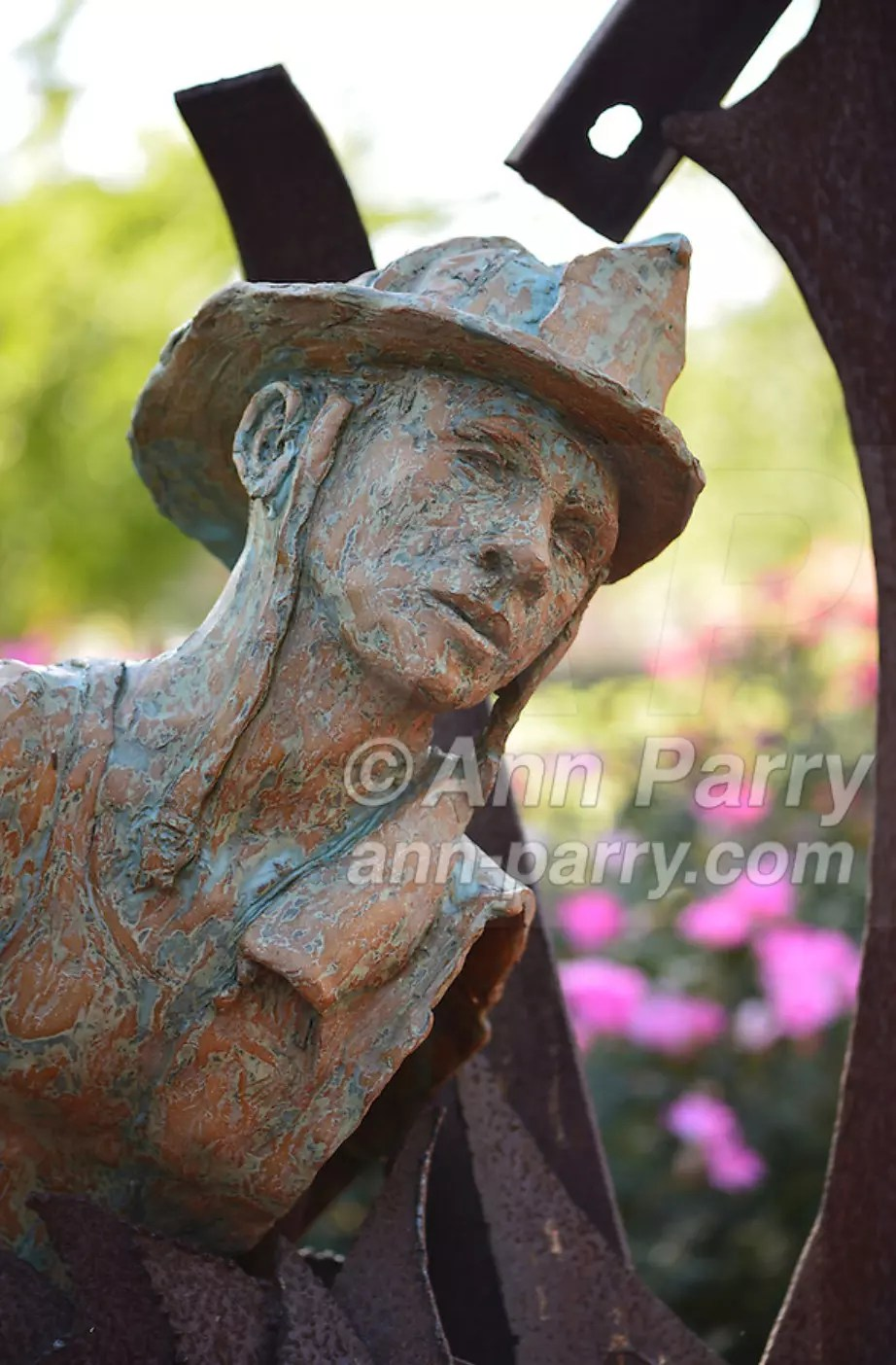 Garden City, NY, U.S. - August 29, 2014 - Adelphi University campus outdoor sculpture in terra cotta and metal of 9/11 theme by artists artist Dan Christoffel in summer