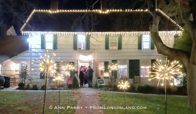 Manhasset, New York, U.S., Dec. 7, 2019. Guests enter historic house, with festive outdoor lights, at Elderfields Preserve during The Art Guild's annual 10x10 Fundraiser Silent Auction and Reception. (© 2019 Ann Parry, AnnParry.com)