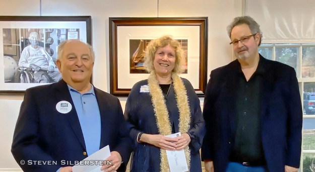 Manhasset, NY, U.S., Feb. 1, 2020. L-R, Board Member DAVE WOLLIN, 1st Place winner ANN PARRY, and Judge HAROLD NAIDEAU pose at The Art Guild exhibition Everything Old is New Again, at Elderfields Preserve. (© 2002 Steven Silberstein)