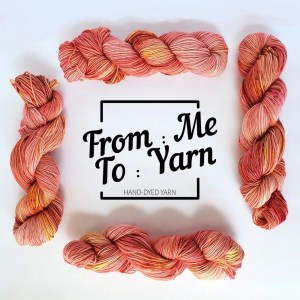 from me to yarn logo inside a 'frame' made up of skeins of coral yarn